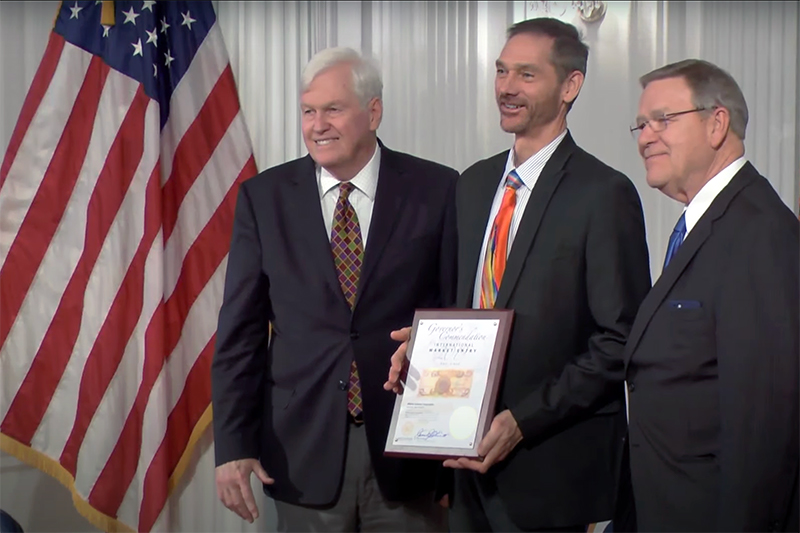 Dan McCaugherty, Athena CEO, receives the Governor's Commendation for International Market Entry from WV Governor Chief of Staff Mike Hall and WV Commerce Secretary Ed Gaunch.