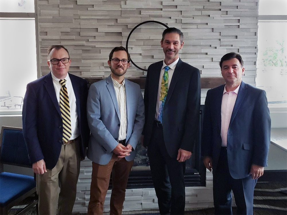 Athena CEO Dan McCaugherty stands with Dr. Matthew Valenti of WVU, Kody West of the CITeR Affiliate Advisory Board, and Dr. Nasser Nasrabadi of WVU.